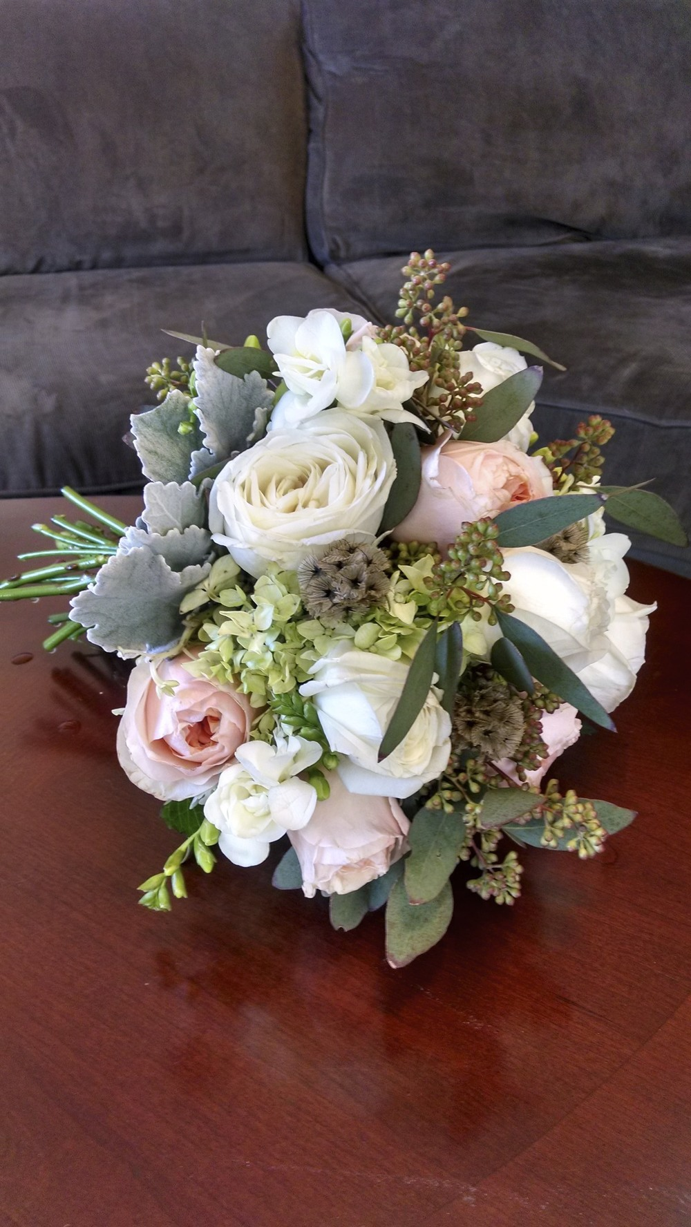 Garden Roses, Freesia, seeded Eucalyptus, Dusty Miller, Scabiosa seedpods.
