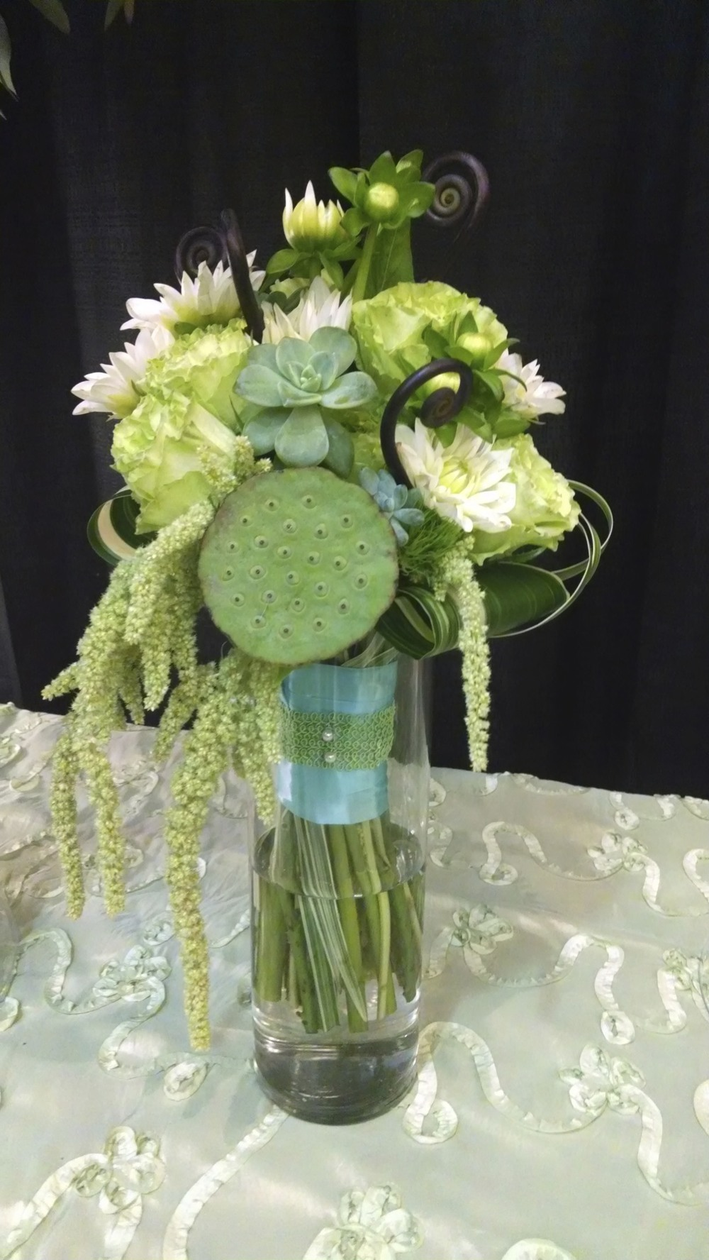 Green Lotus pods, Roses, Amaranthus, Succulents, Dahlias and fiddle-head Ferns.