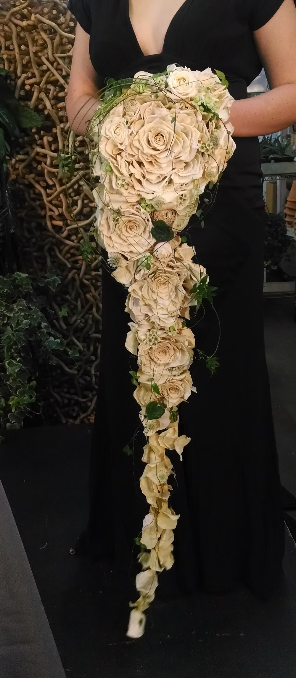 My personal favorite.  This is made out of preserved roses!  A super lightweight, absolutely stunning bouquet that will last forever.  I hope I get the chance to make one soon.