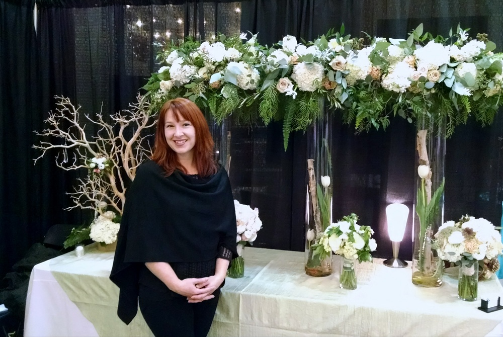 Tami McAllister, Pink Bridal Show Flower Display.  Blush, Neutrals, Natural theme for main display, including sahara roses, blush ranunculus, french tulips, hydrangea & eucalyptus.