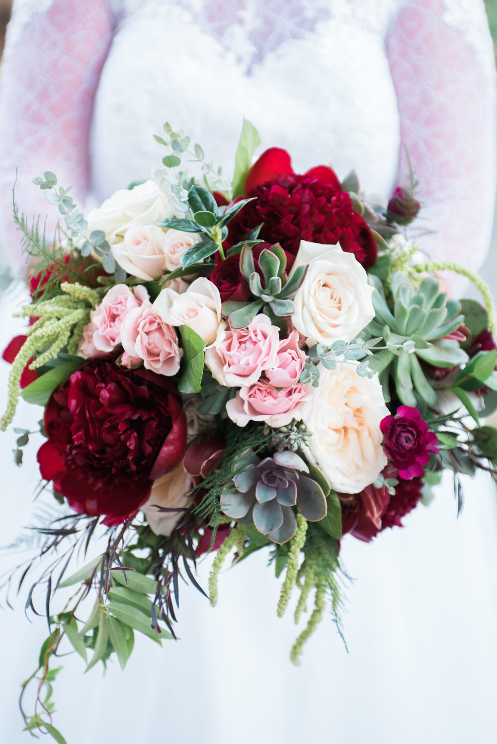 Red Charm Peonies, White Ohara Garden Roses, Majolica Spray Roses, Succulents and Amaranthus.  Photo by Martha Howell Photography.  Coffey Barn, Cleveland TN