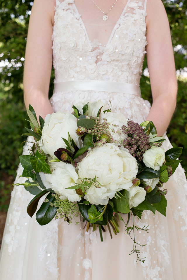 Peonies, Lisianthus, Burgundy Queen Anne's Lace and Magnolia Leaves.  Photo by Kenney Photography.  Waterhouse Pavilion, Chattanooga TN