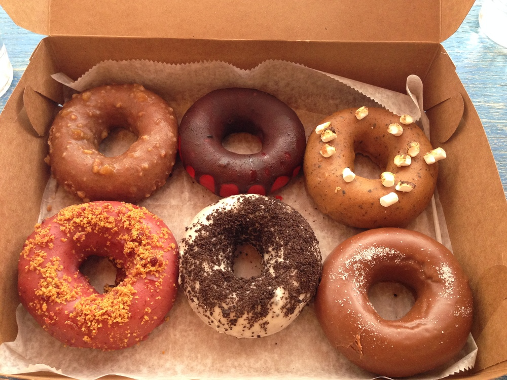 The Federal Donuts six-pack, top row: Sticky bun, Chocolate Strawberry, Marshmallow Marshmallow. Bottom row: Crumberry, Cookies & Cream, Chocolate Sea Salt. They did not look like this for long.