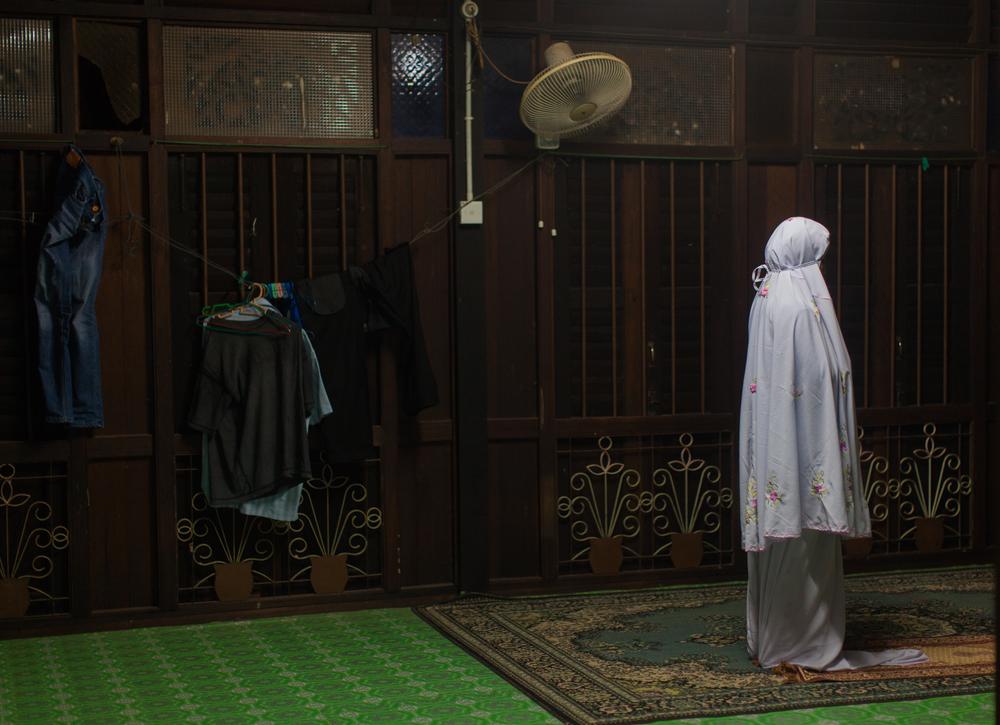 Nur Faseeha Suhaimi prays in her grandmother's home in Kuala Muda in Kedah, Malaysia. Aug 9, 2014.