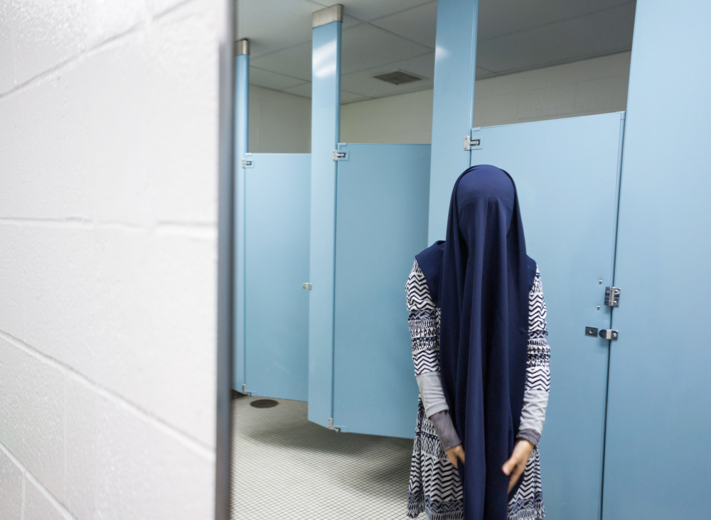 Fatini re-veils her hijab before finding a place to pray in between her classes. Dec 4, 2013.