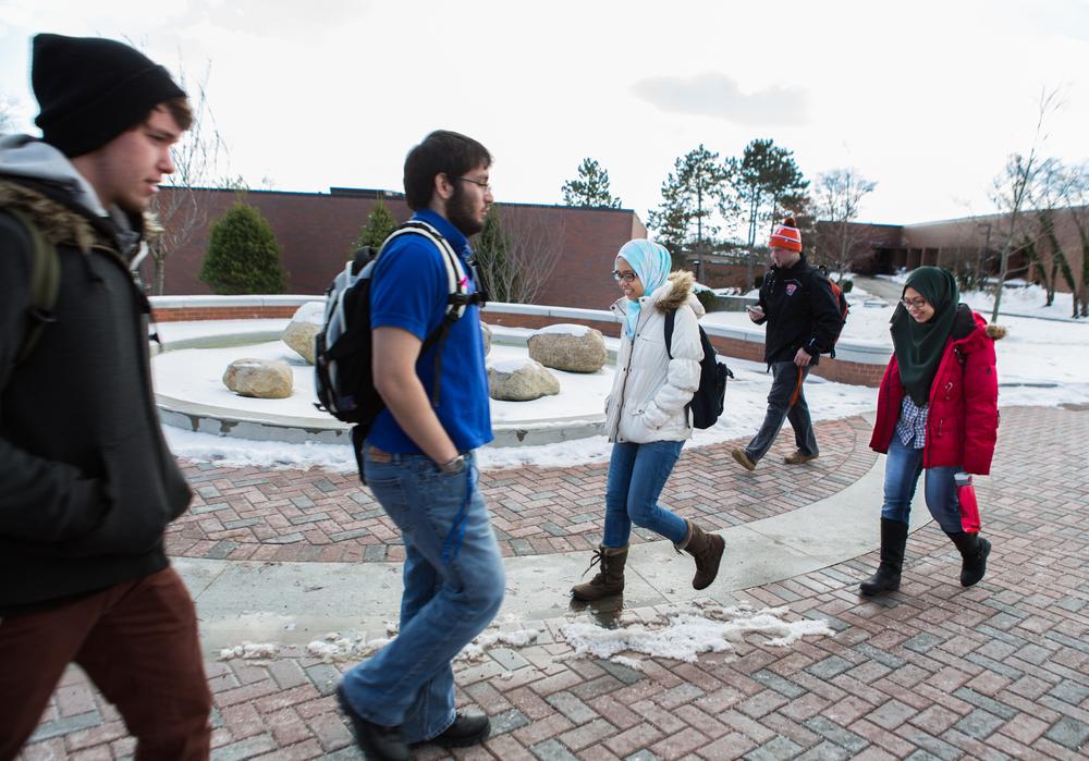 Zur Raiha and Filza Zaheera walk across the RIT campus to class, Nov 21, 2014.