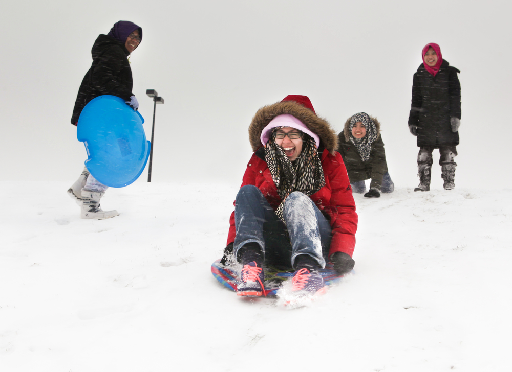 Norazleen pushes Filza Zaheera down a hill on campus, Dec 14, 2013. This was Filza's first time sledding.