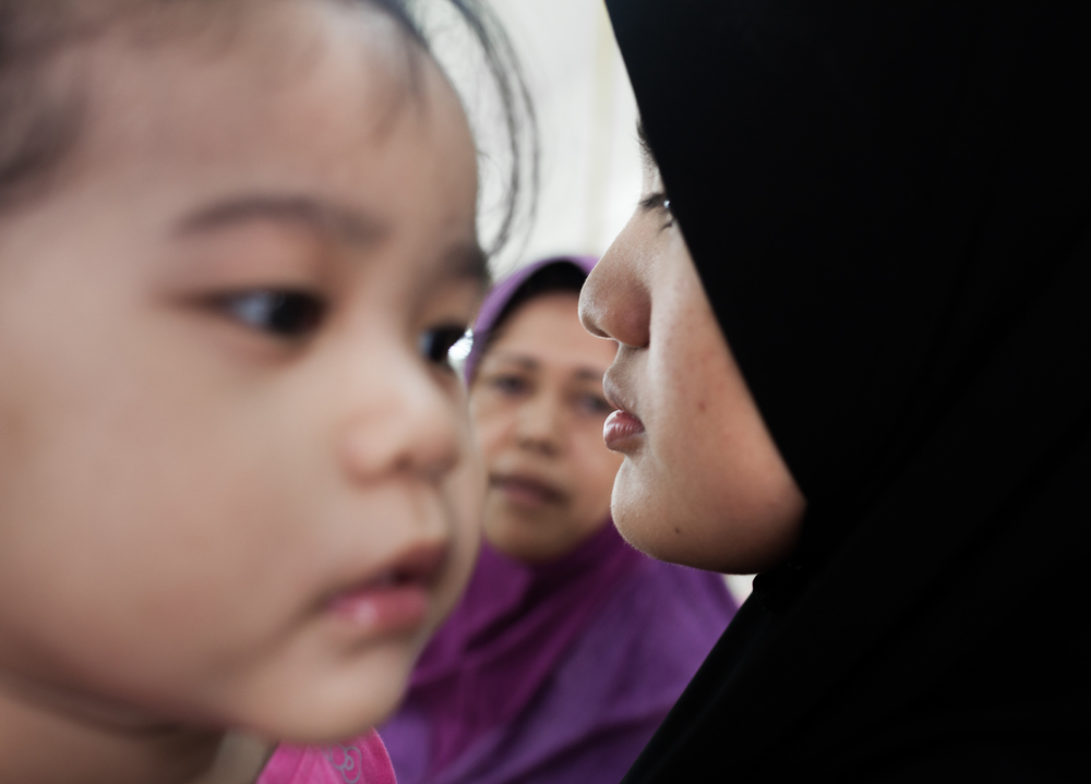 Norazleen Hashim holds her niece, Adelia while shopping with her mother in Klang, Selangor, Malaysia on Aug 8, 2014.
