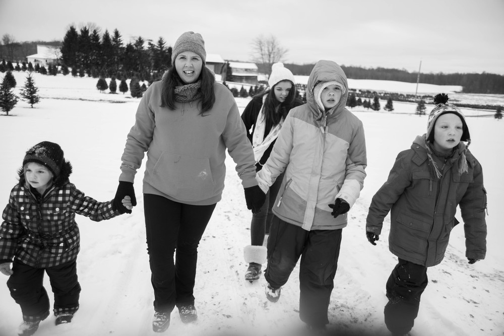Bridget holds hands with her 4 children while searching for a Christmas tree, Nov 30, 2013. Left to right, Kerrigan, McKenzie, Bailey and Zachary.