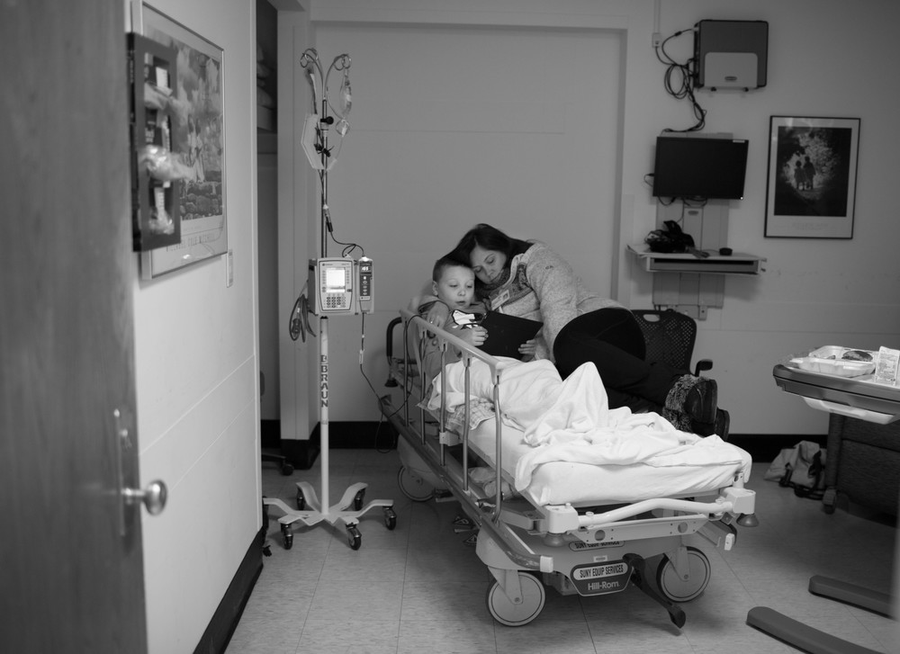 Zachary and his mother Bridget sit and wait for blood at Upstate University Hospital in Syracuse N.Y., Dec 18, 2013.