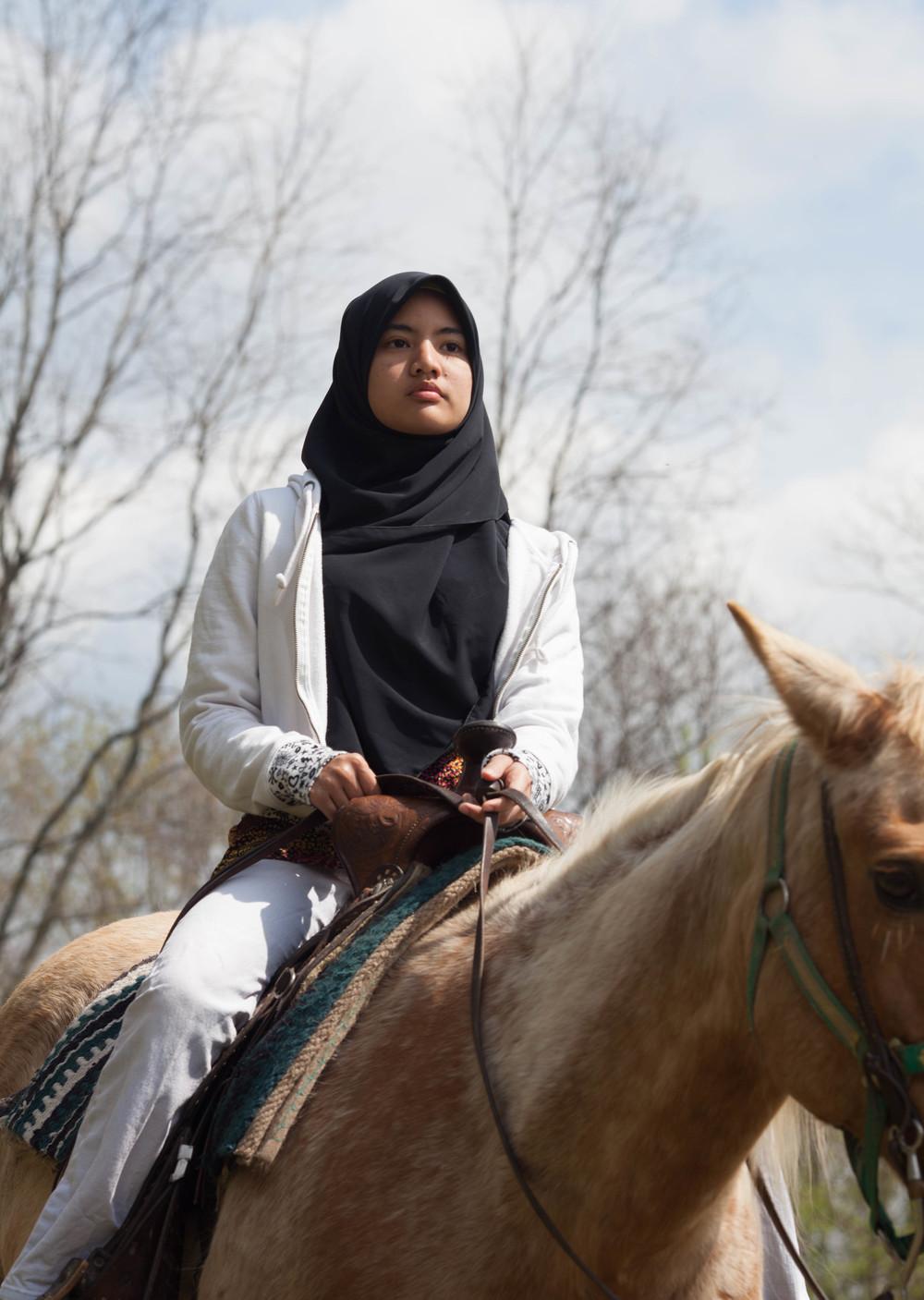 Azleen Hashim rides horseback, Rochester NY.