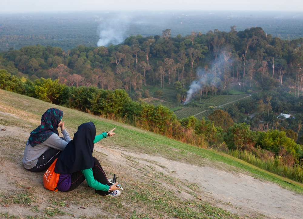 Riana Alias and her sister Aliyana sit and look at crops from the top of Jugra Hill in Jugra Selengor, Malaysia on Aug 4, 2014. Riana graduated RIT in 2013 and is now pursuing a PhD in Malaysia.