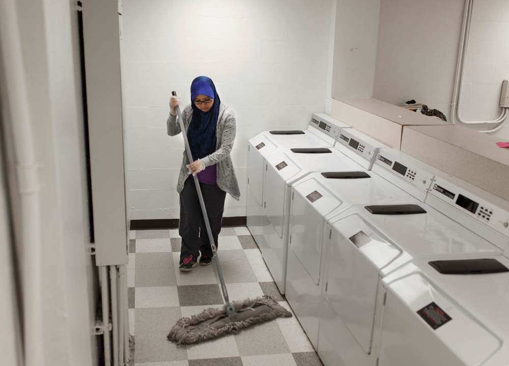 Nadia works on campus mopping and cleaning the laundry rooms in the dormitories. Rochester Institute of Technology, May 4, 2014. Many of the women do janitorial jobs with shifts that begin at 6:00 am on weekends.