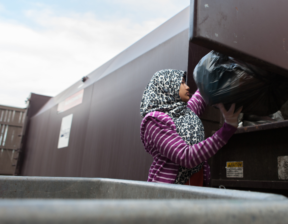 "Norazleen Hashim takes out the trash from the dormatories at Rochester Institute of Technology, May 4, 2014. Norazleen works as a janitor on the weekends and has given herself the nickname of ""Trash Girl."""