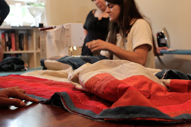 Maura Grace Ambrose, at her Bernina sewing machine.