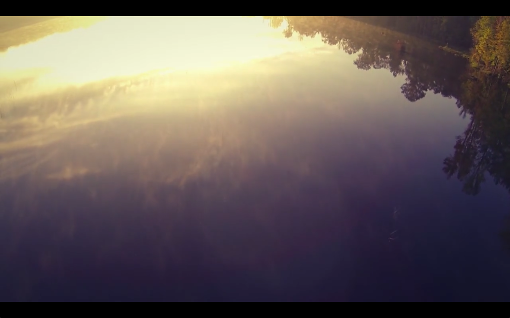 A still from the film. This is the lake on the edge of the field where we got married.