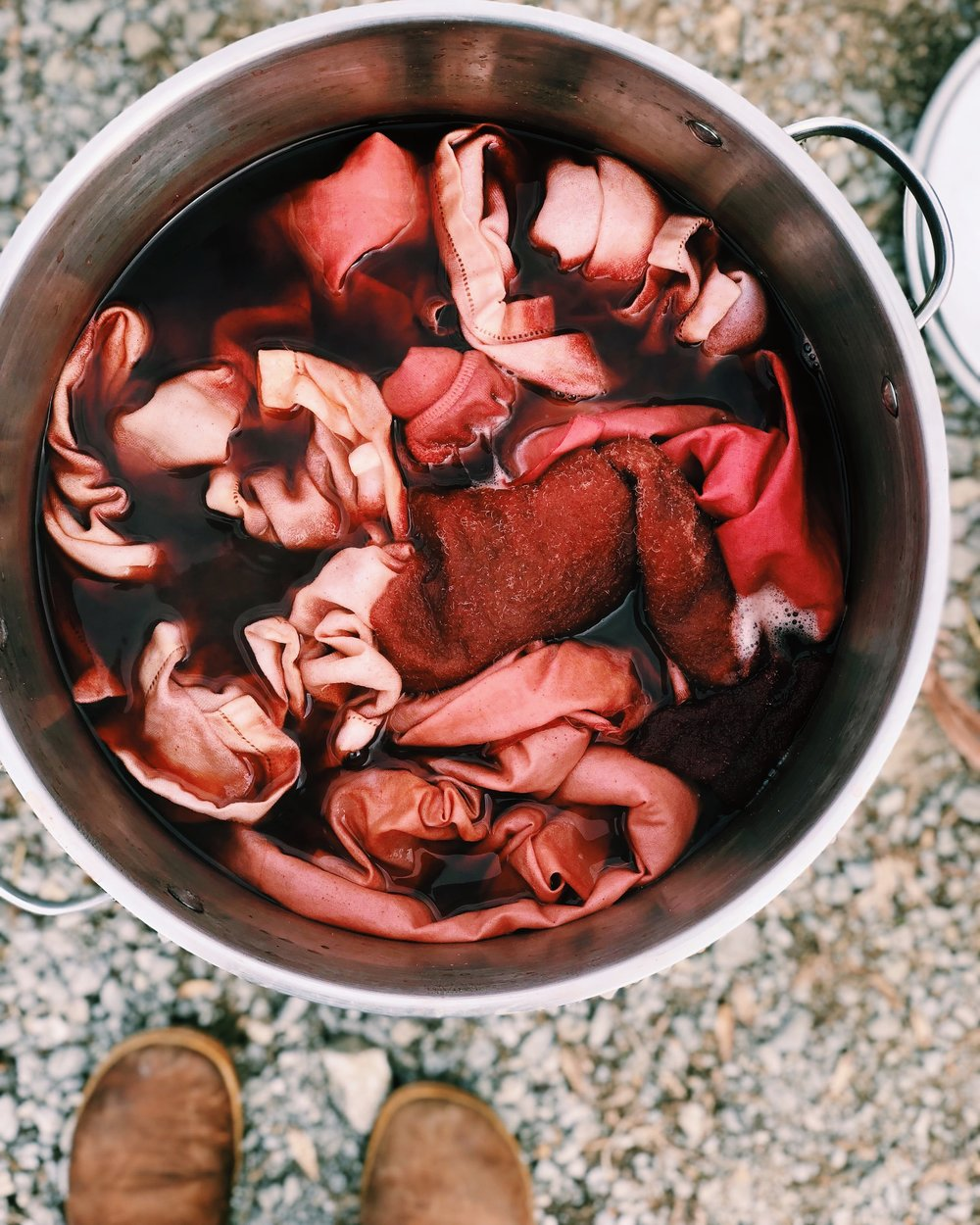 A pot of madder root dye with cotton and wool.