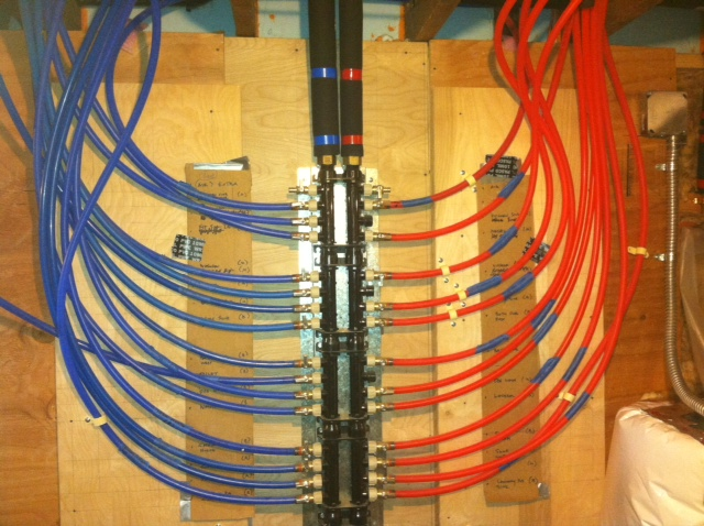 plumbing pex manifold with installed tubing.JPG