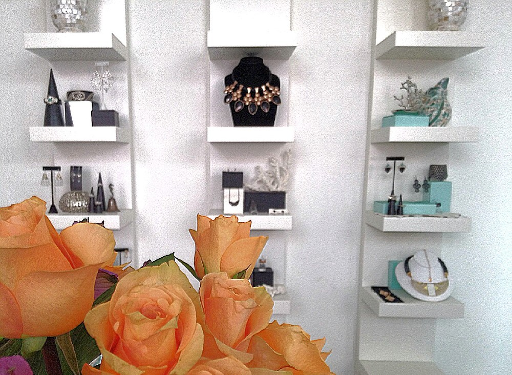 Beautiful jewelry vignettes + fresh flowers in the showroom.