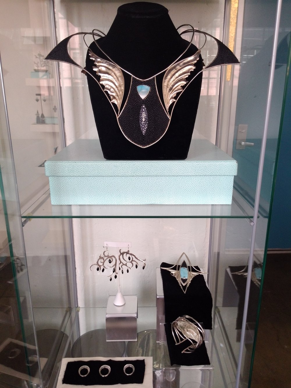 One of a kind pieces in fine silver, stingray skin, larimar, black diamond, and black onyx.