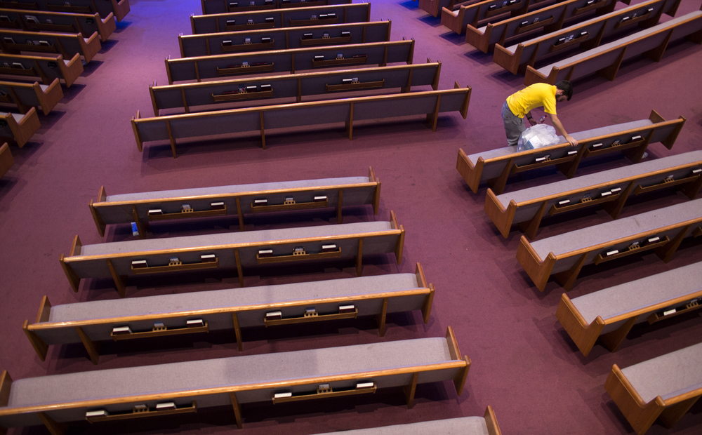 A young boy cleans up after the Potomac Men's Conference at the Trinity Life Church in Lutherville, Maryland. Several thousand men attended the conference where they celebrated their love for Christ and learned how to utilize his teachings in their daily lives.