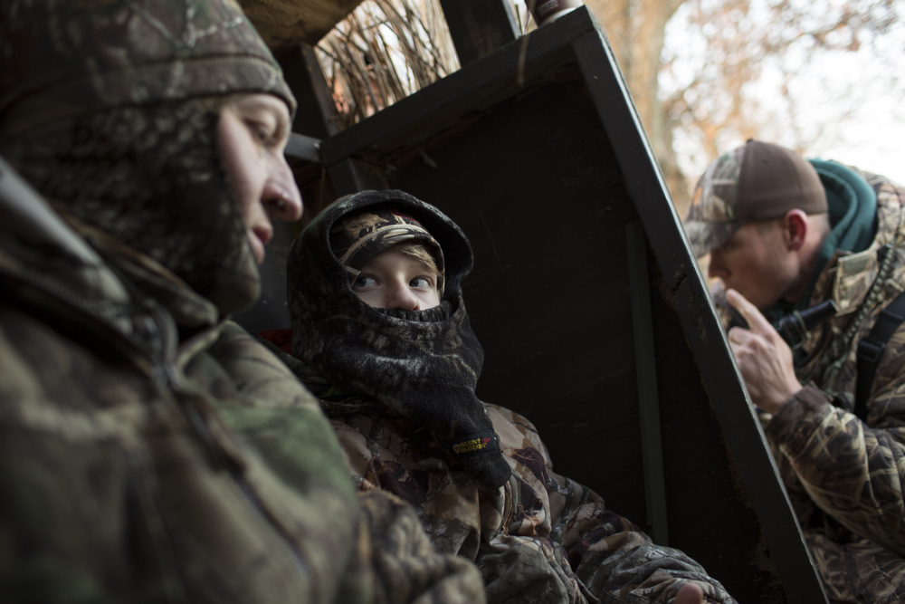 Cruz listens to a lesson from his father while sitting in a hunting blind during a goose hunt on the Eastern Shore of Maryland, near Easton.