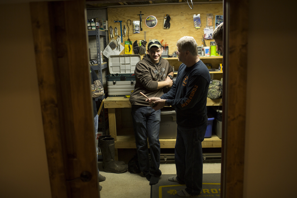 Tracy gives a group of younger hunters a turkey call demonstration in the basement of his home in Eldersburg, Maryland.