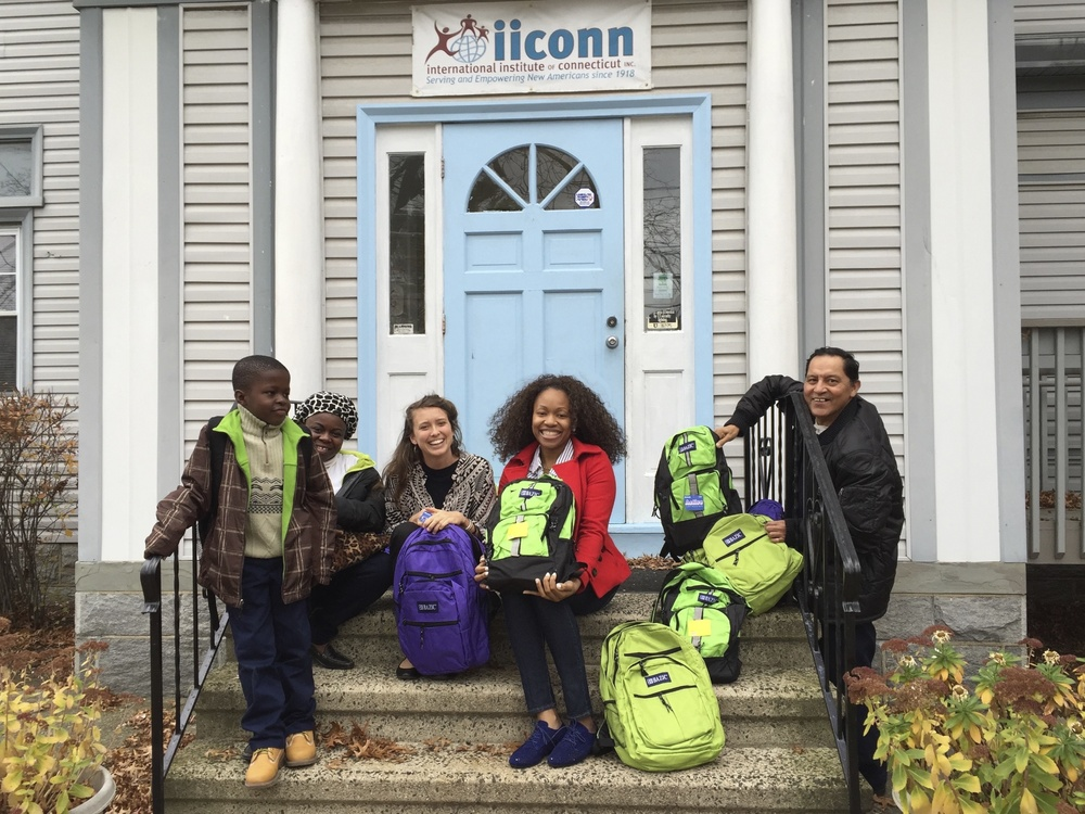 Helen and Doyin of IICONN with one of their client families and Julio from Books4Everyone in front of their headquarters in Bridgeport