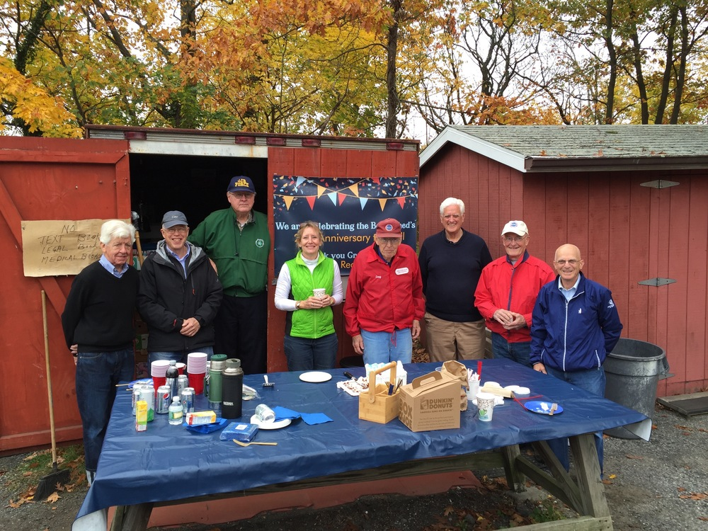 Lorrie Stapleton and Doug Francefort with the volunteers at the Greenwich Book Shed