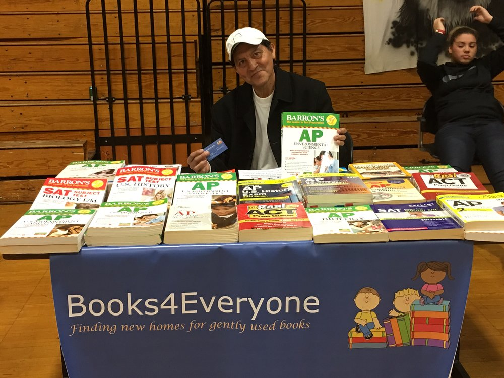 Julio Reinoso at a Bassick High book fair