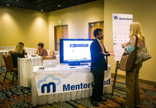 CEO Ravi Gundlapalli talking to interested NAWBO members about MentorCloud
