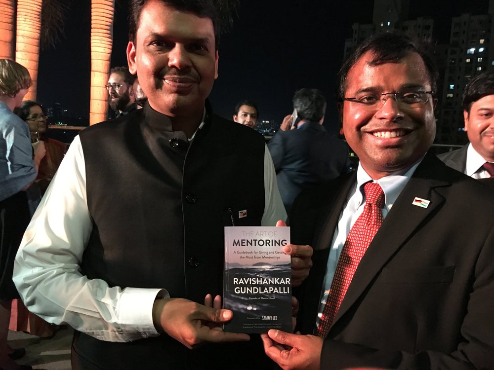 Shri Devendra Fadnavis, Hon Chief Minister of Maharashtra, India. Blessed to be giving one of the first five copies to him at Delivering Change Forum 2017 conference in Mumbai, India.