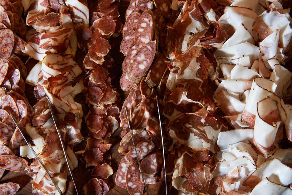 Charcuterie, L-R Fullsteam Carver & Friends Salami, Dusty Foothills Coppa, Peach and Corno Di Toro Lonzina, Old World Beef and Pork Salami, Carolina Hot Lamb Ham, Blueberry and Appalachian Wild Ginger Short Loin, Mole & Pumpkin Seed Salami