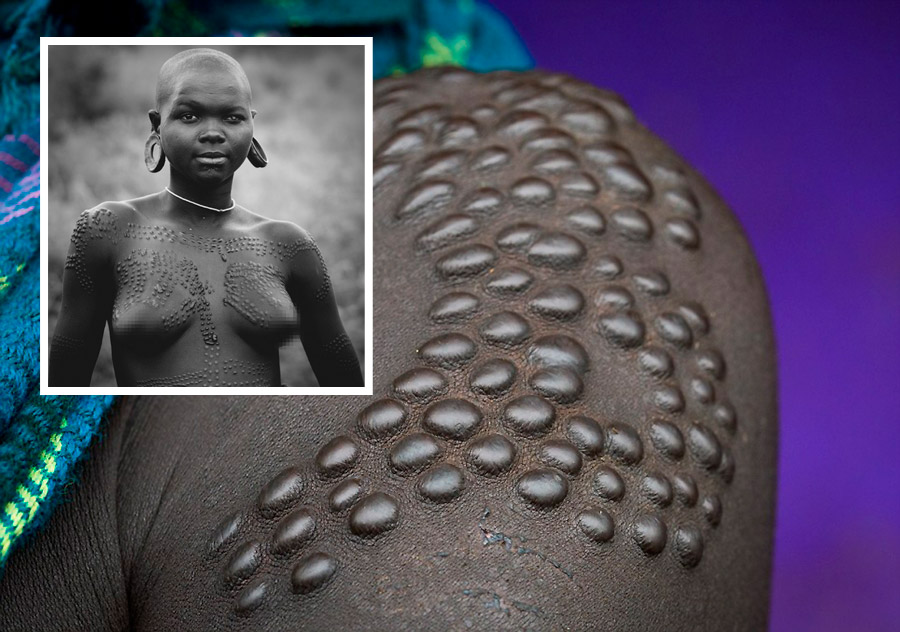 During  Scarification  cuts have organic sap or ash rubbed into them to make them heal as raised bumps