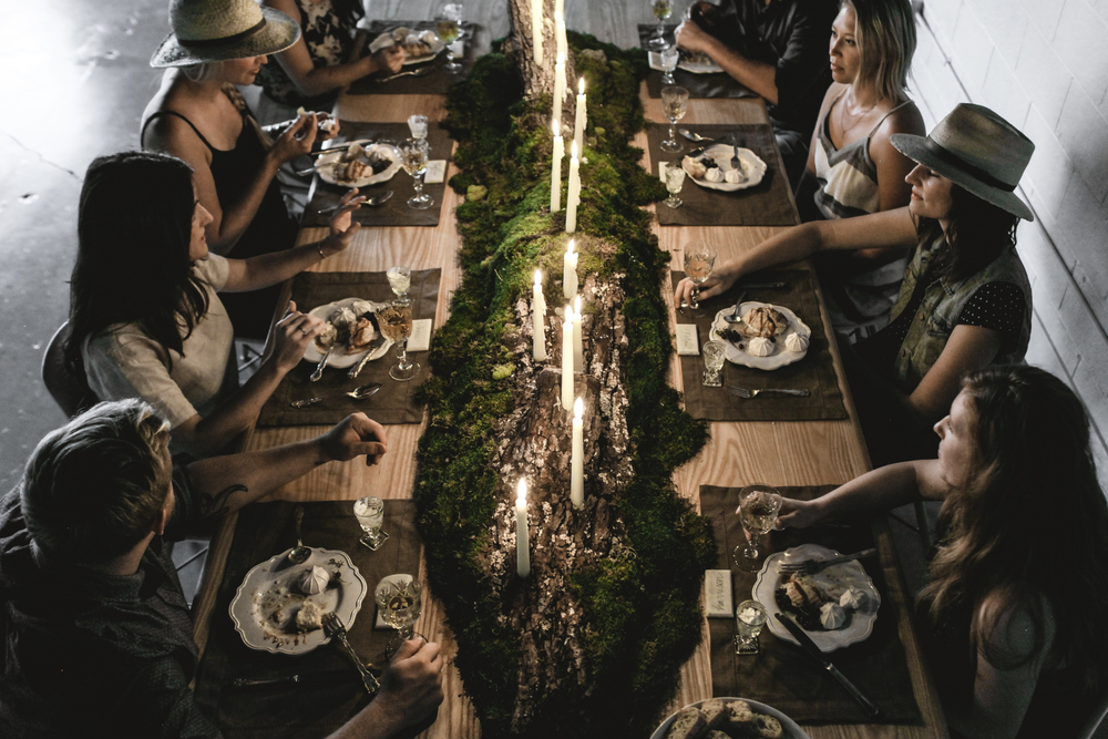 Photo by Tiffany Mitchell, for #SocialFare. Centerpiece is a custom made overgrown walnut log turned candelabra. Natural Elements played against the cut crystal stemware and high end place settings.