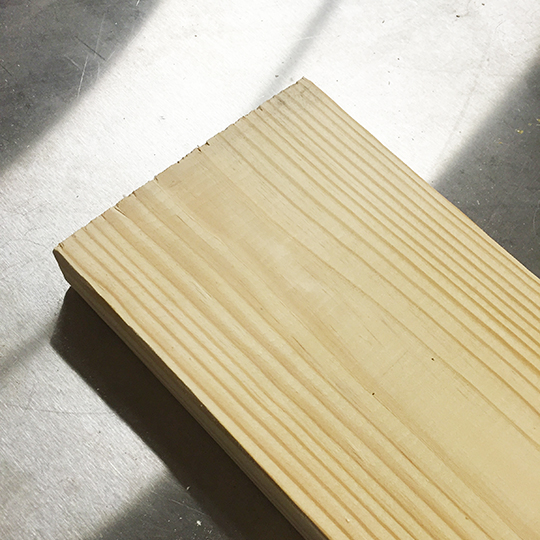 A fresh clean pine board, ready to get slapped.