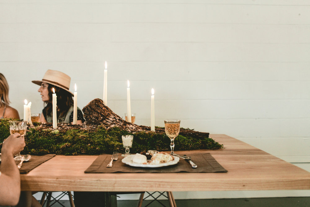 Walnut log made into a candelabra and nestled amidst the fanciest of fancy.  I'd say that sounds perfect.