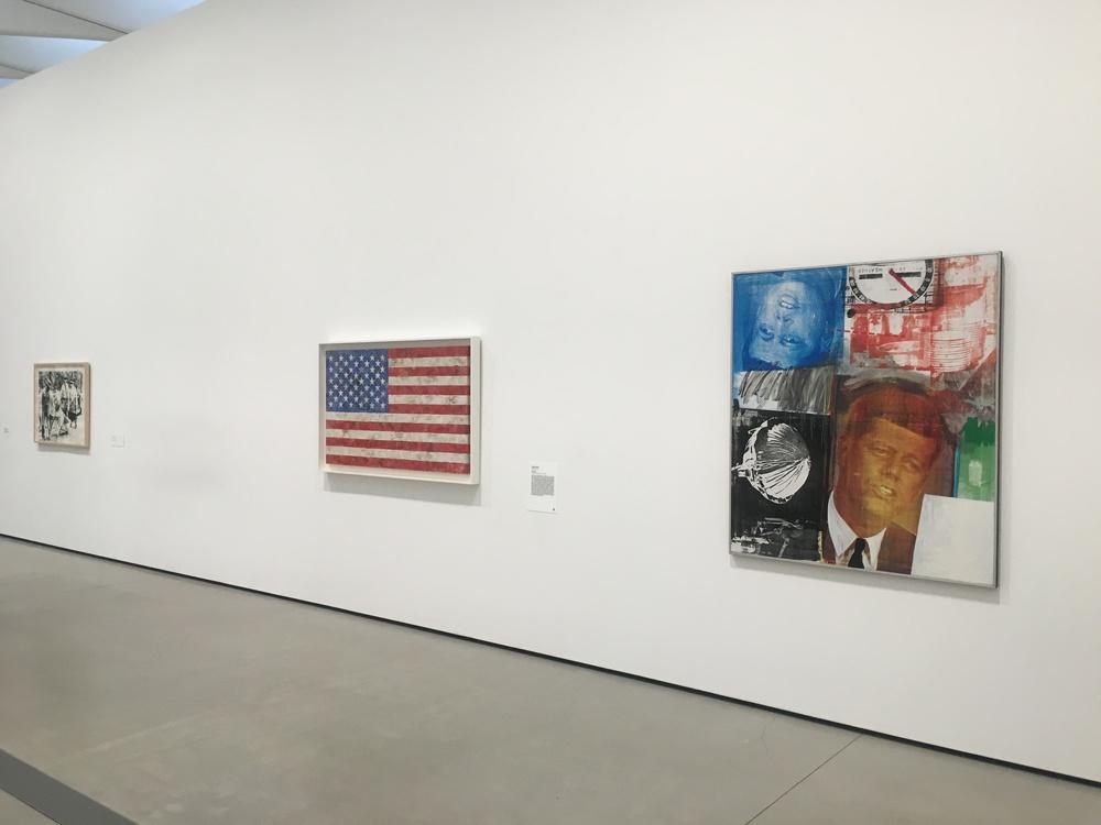 Andy Warhol Race Riot 1963, Jasper Johns Flag 1967, and Robert Rauschenberg's Untitled 1963.