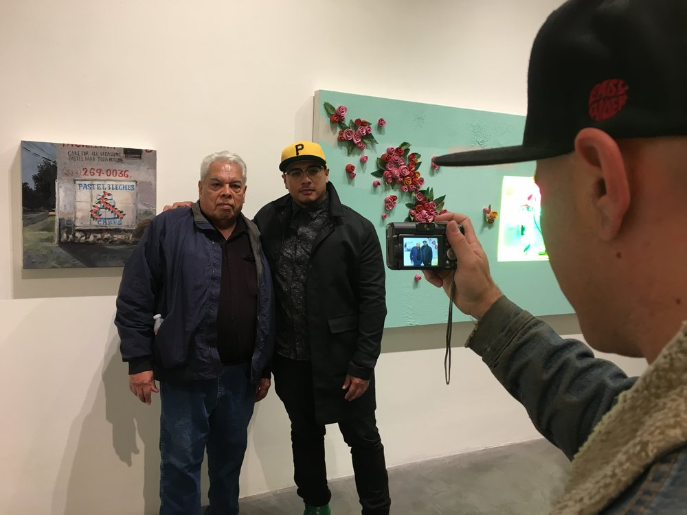 Patrick Martinez and his pops getting their portrait taken.