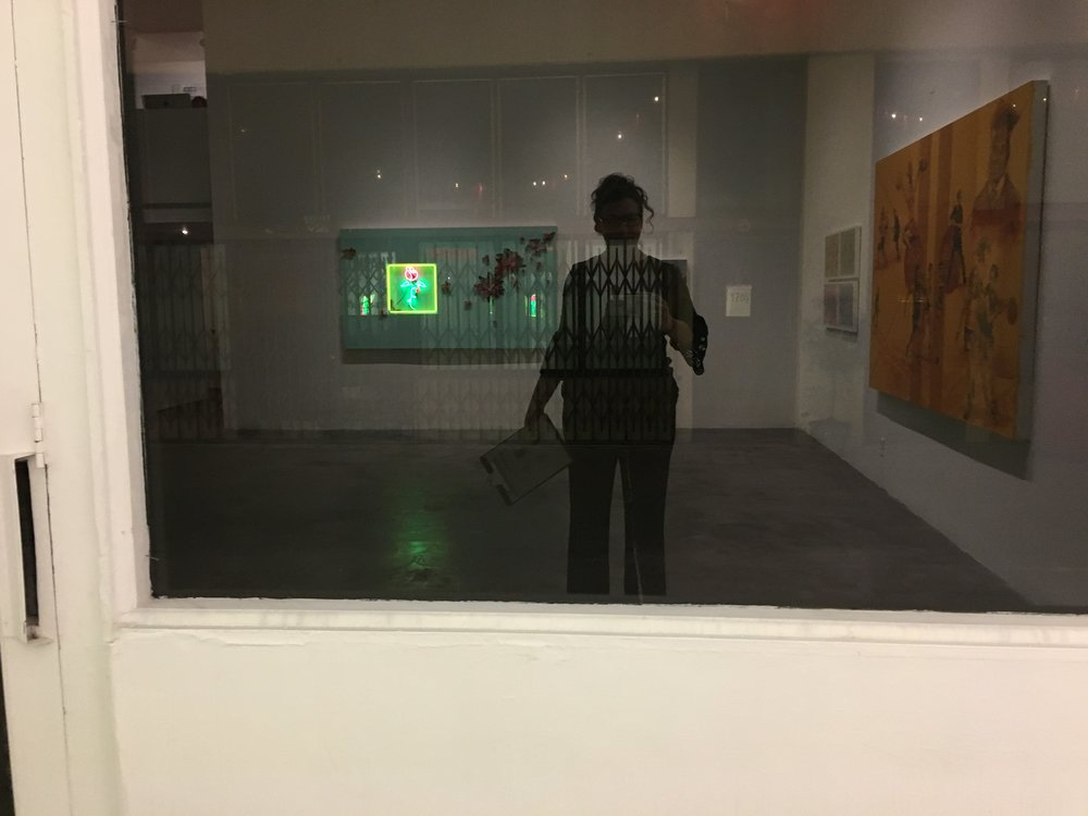 Selfie in the window of Charlie James Gallery before the crowds showed up.