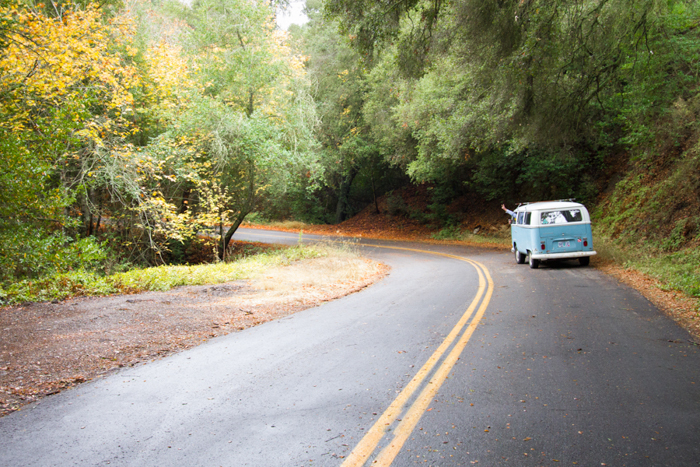 couple on road trip in old volkswagon bus