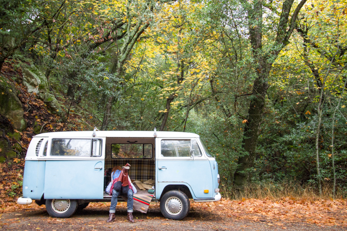 couple in old volkswagon bus