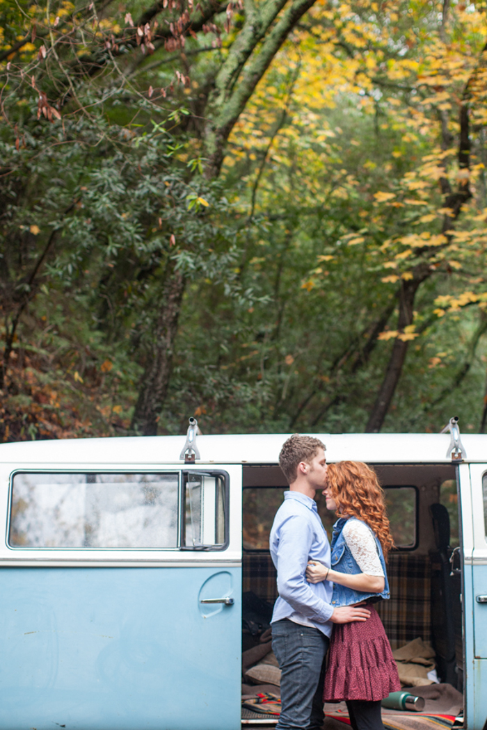 couple kissing in front of old volkswagon bus