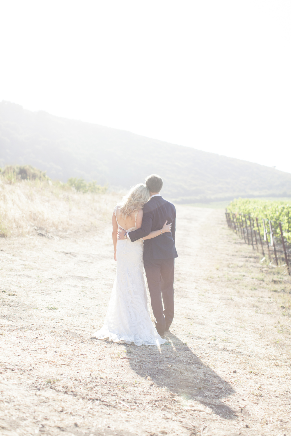 Romantic Sanford Winery wedding portrait  by San Luis Obispo wedding photographer Skyla Walton