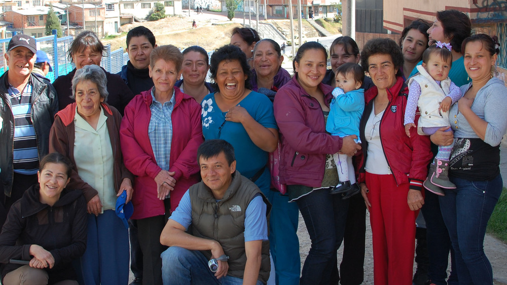 "The face of the real ""Colombian Girl"" behind our jewelry, pictured here with their families.  This group of Colombian women artisans working behind the scenes to produce our jewelry span multiple generations, representing a broad spectrum of Colombian culture and history, at the heart of our jewelry."