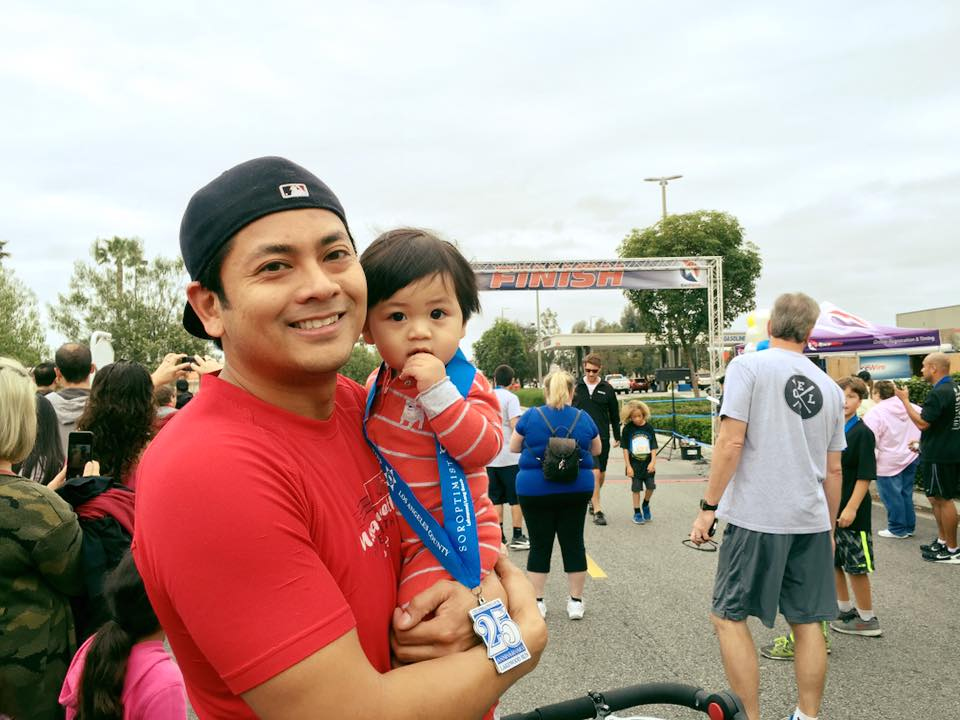 At the finish line of Julius's first race at the Lakewood 5k on March 5, 2016.  Julius beat Ruben by the length of a B.o.B baby stroller!