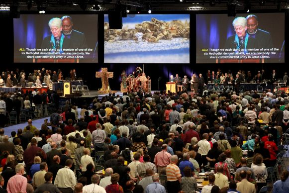 Delegates and visitors at the 2012 United Methodist General Conference in Tampa, Florida. Bishop Sharon Zimmerman Rader and Bishop John White are on the screens. Photo credit: Kathleen Barry/UMNS