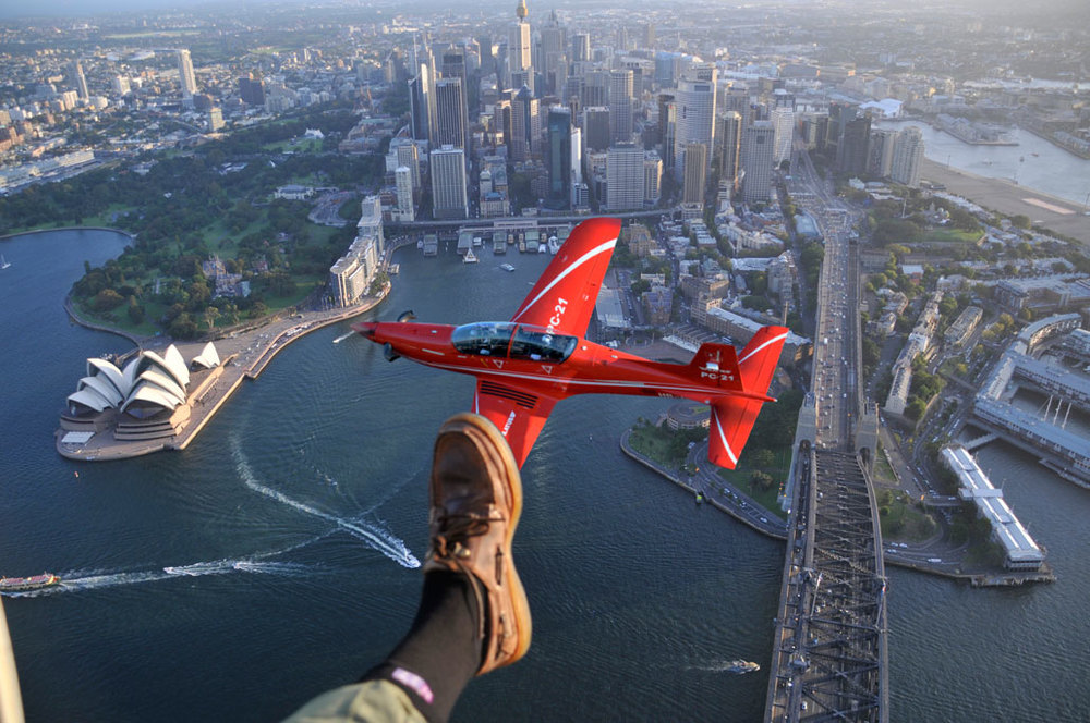 Pilatus PC21 over Sydney Harbour, from an AS350 helicopter flown by David Adamson