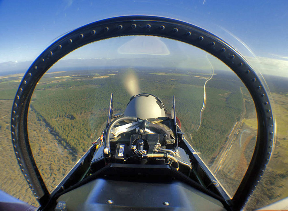 The view from the rear seat of a PC9 as it clears the forest, on the approach to RAAF Pearce in Western Australia