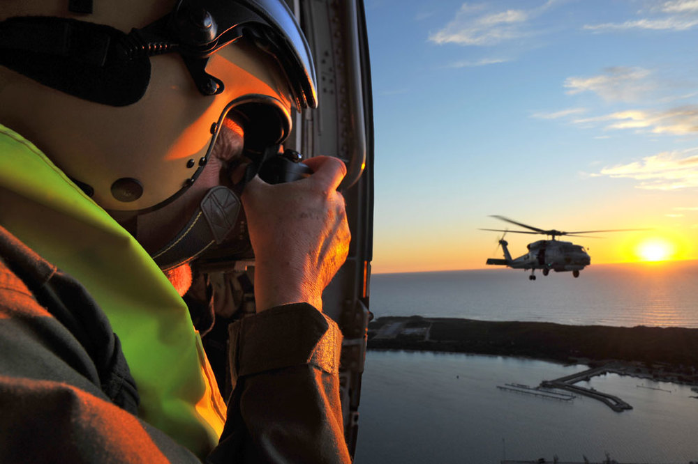 John shooting from an S70B Seahawk to a scond one, over WA's HMAS Stirling